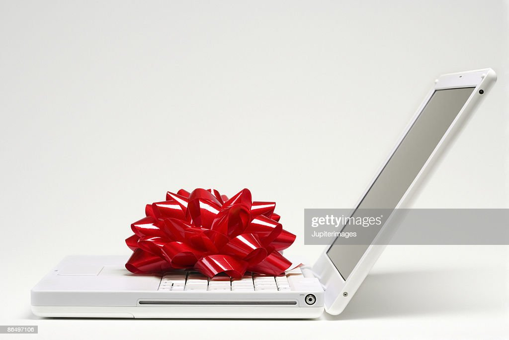 Red bow on laptop computer : ストックフォト