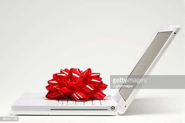 Red bow on laptop computer