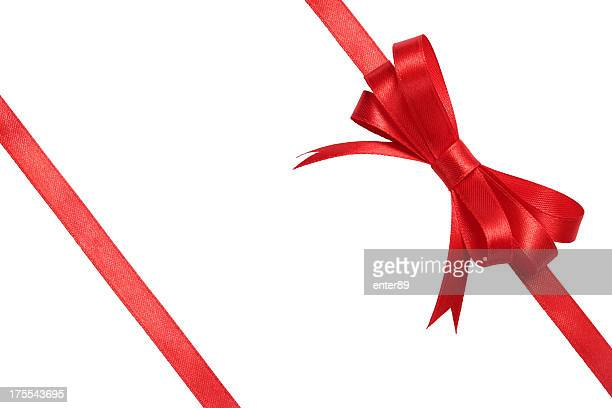 Red bow wrapped around white background