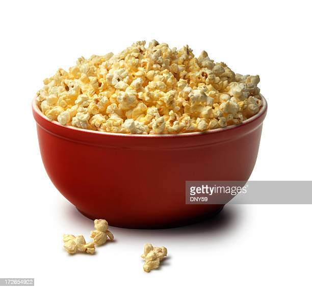 Red bowl of popcorn on a white background