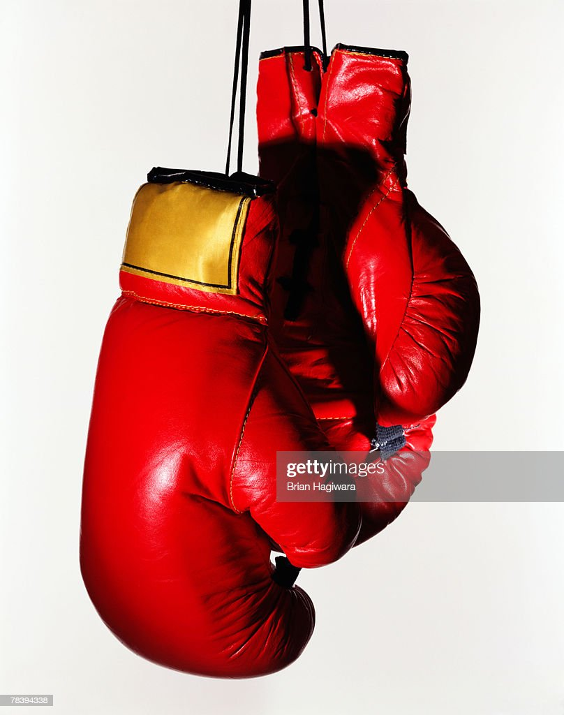 Red boxing gloves on white : Stock Photo