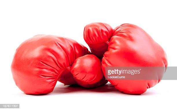 Red boxing gloves stacked on each other