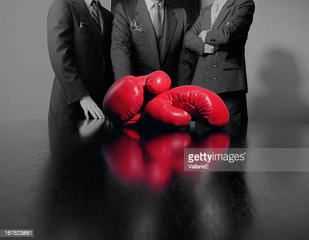 Red Boxing Gloves with Business Persons