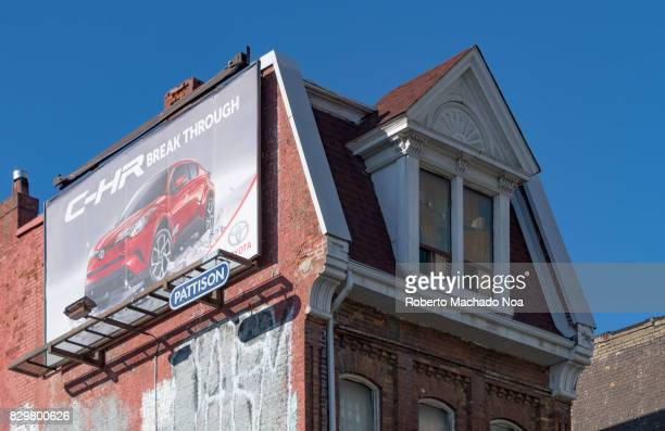 Red brick Victorian facade with a Pattison advertisement on the lateral wall in Queen Street West The heritage neighbourhood is a popular tourist...