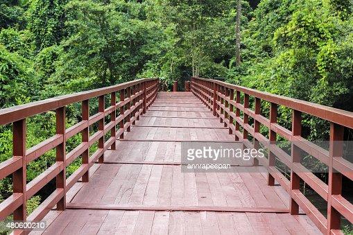 Red Bridge across the creek : Stock Photo