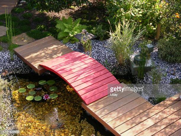Red bridge with pond