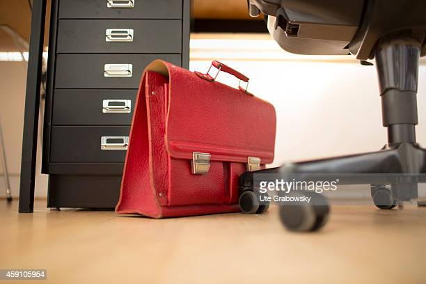 Red briefcase standing under a desk on August 12 in Duelmen Germany Photo by Ute Grabowsky/Photothek via Getty Images