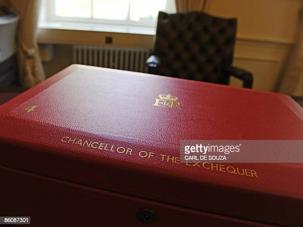 A red briefcase traditionally used by British Finance Ministers to present annual Budget reports is pictured on Alistair Darling's desk during a...