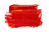 Brush stroke of red acrylic paint closeup isolated on the white background