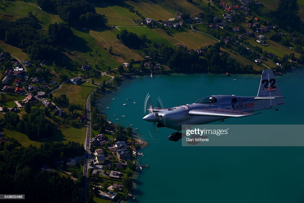 Red Bull Air Race pilot <a gi-track='captionPersonalityLinkClicked' href=/galleries/search?phrase=Hannes+Arch&family=editorial&specificpeople=4511432 ng-click='$event.stopPropagation()'>Hannes Arch</a> flies next to the Red Bull Douglas DC-6B during a Red Bull Racing media flight to Hangar 7 on June 29, 2016 in flight over Austria.