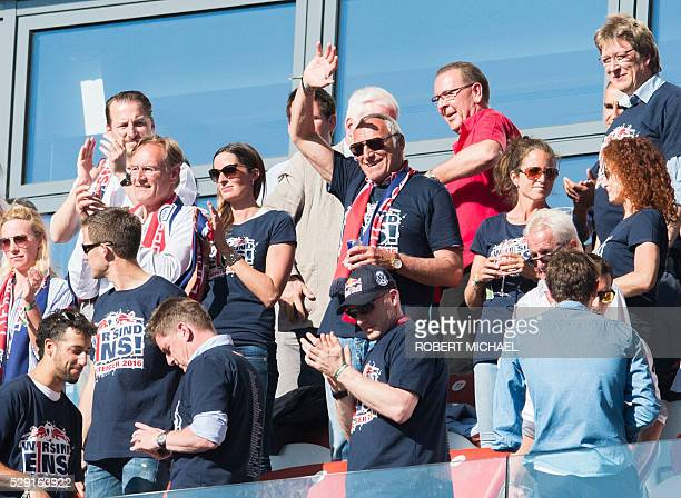 Red Bull Austrian founder Dietrich Mateschitz waves from the VIP stands after the German second division Bundesliga football match between RB Leipzig...