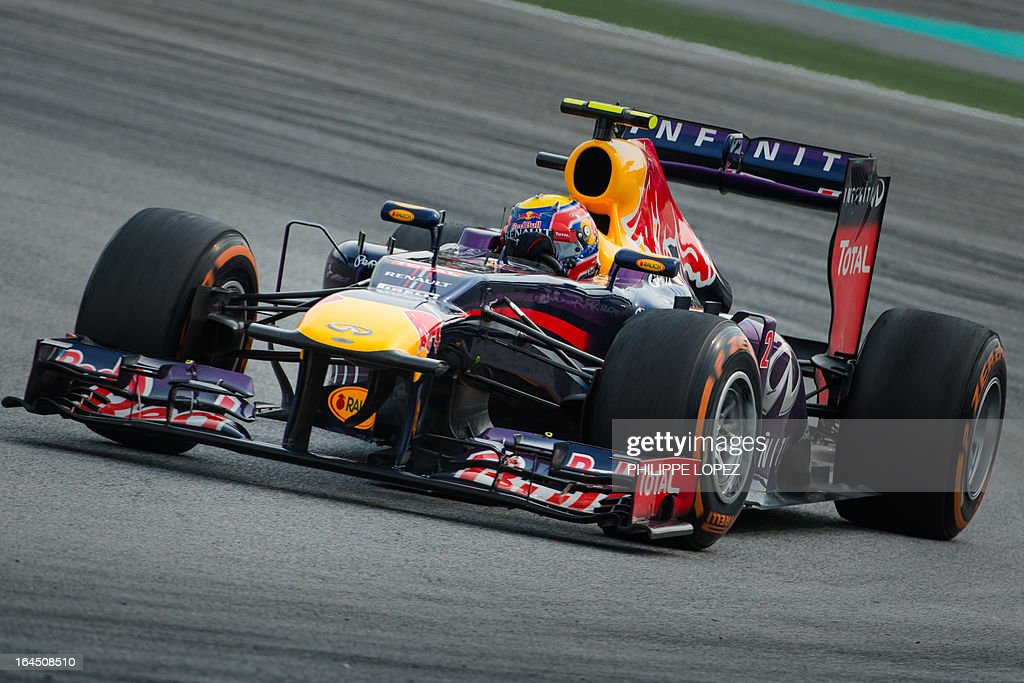 Red Bull driver Mark Webber of Australia drives during the Formula One Malaysian Grand Prix in Sepang on March 24, 2013. Webber finished second in the race. AFP PHOTO / Philippe Lopez