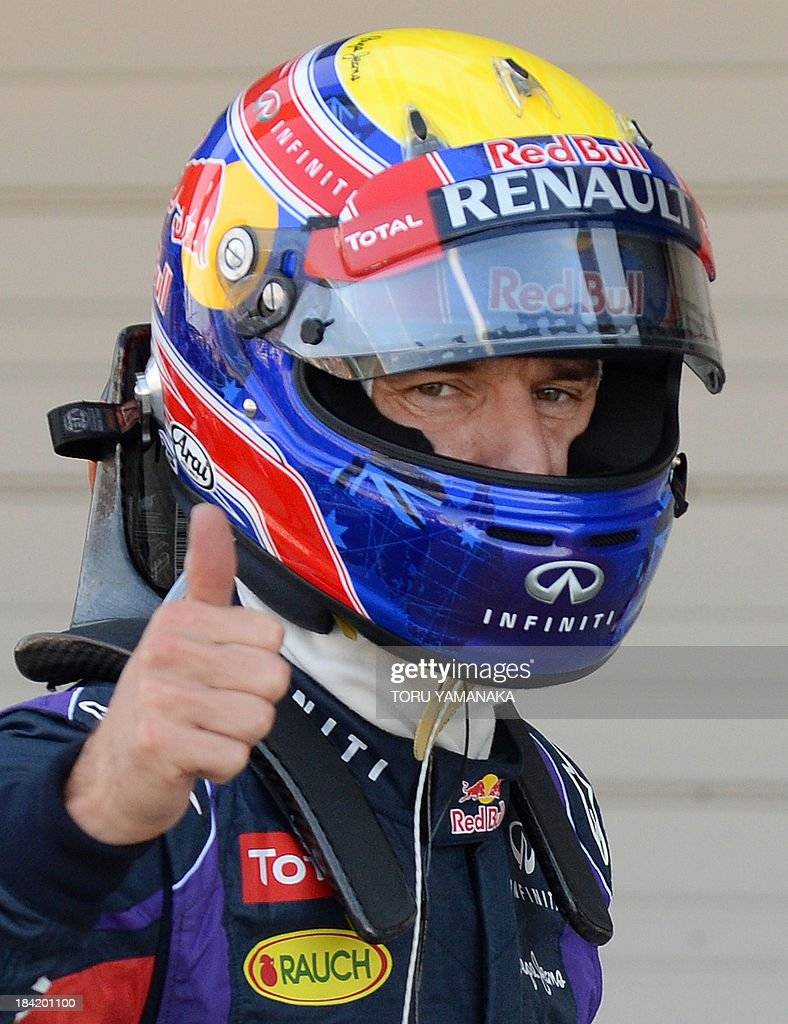 Red Bull driver Mark Webber of Australia gives a thumbs up gesture after the qualifying session ahead of the Formula One Japanese Grand Prix in Suzuka on October 12, 2013. Webber clocked the fastest time to get the pole position. AFP PHOTO/Toru YAMANAKA