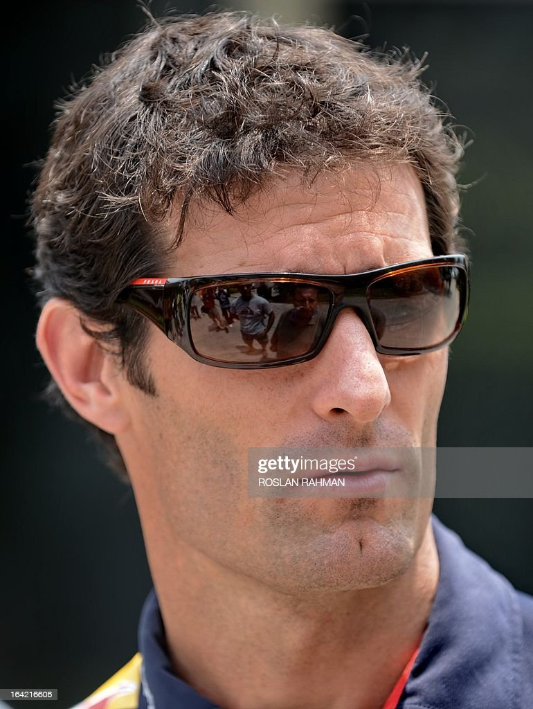 Red Bull driver Mark Webber of Australia is seen along the paddock ahead of the Formula One Malaysian Grand Prix at Sepang on March 21, 2013. The Malaysian Grand Prix will take place on March 24.