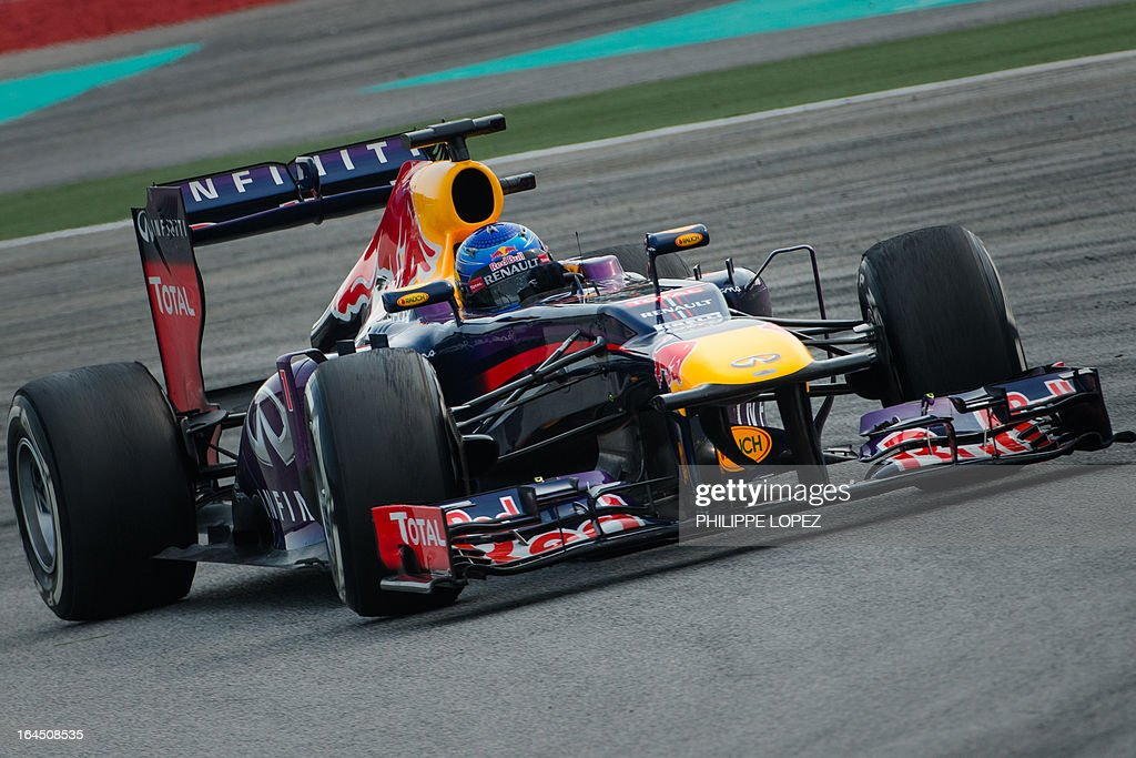 Red Bull driver Sebastian Vettel of Germany drives during the Formula One Malaysian Grand Prix in Sepang on March 24, 2013. AFP PHOTO / Philippe Lopez