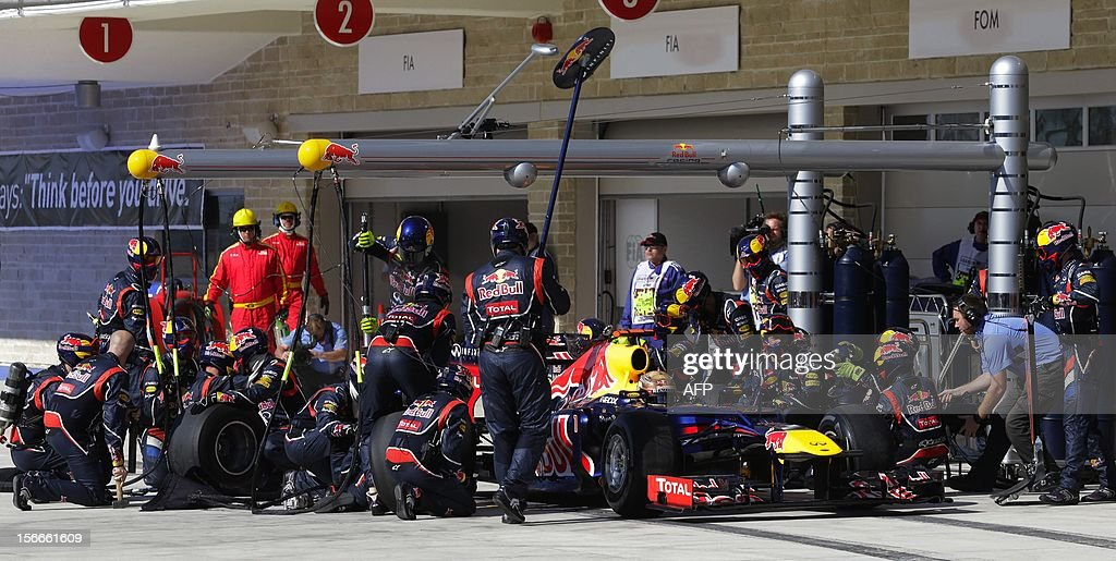 Red Bull driver Sebastian Vettel of Germany gets a pit service during the Formula One US Grand Prix auto race at the Circuit of the Americas race track in Austin, Texas, on November 18, 2012 AFP PHOTO/POOL/Luca Bruno