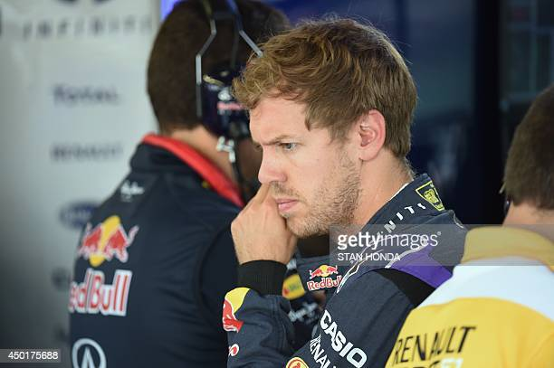 Red Bull driver Sebastian Vettel of Germany in the pits at the Circuit Gilles Villeneuve in Montreal on June 6 2014 during the first practice session...