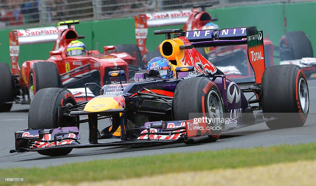 Red Bull driver Sebastian Vettel of Germany leads the Ferraris through a corner during the Formula One Australian Grand Prix in Melbourne on March 17, 2013. AFP PHOTO / Paul CROCK USE