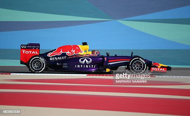 Red Bull driver Sebastian Vettel of Germany steers his car during the third practice session of the Formula One Bahrain Grand Prix at Bahrain's...