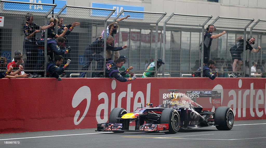 Red Bull driver Sebatian Vettel of Germany crosses the finish line during the Formula One Indian Grand Prix 2013 at the Buddh International circuit in Greater Noida, on the outskirts of New Delhi on October 27, 2013. AFP PHOTO/ Prakash SINGH
