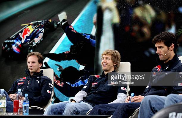 Red Bull F1 driver and new world champion Sebastian Vettel and team mate Mark Webber with team Principal Christian Horner and technical director...