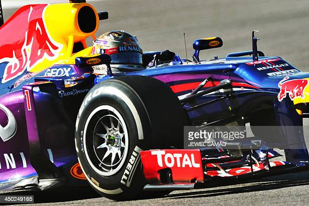 Red Bull German driver Sebastian Vettel races during the United States Formula One Grand Prix at the Circuit of The Americas on November 17 2013 in...