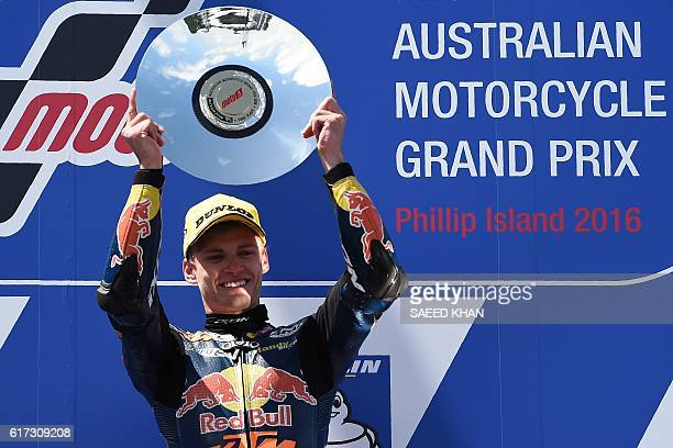 Red Bull KTM Ajo South African rider Brad Binder celebrates his victory on the podium after the Moto3 race at the Australian Grand Prix at Phillip...
