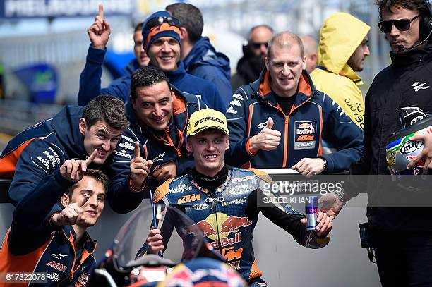 Red Bull KTM Ajo South African rider Brad Binder celebrates his victory with teammates after the Australian Moto3 race at Phillip Island on October...