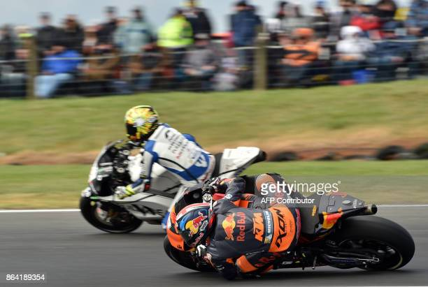 Red Bull KTM rider Bradley Smith of Britain negotiates a corner during the qualifying session of the Australian MotoGP Grand Prix at Phillip Island...
