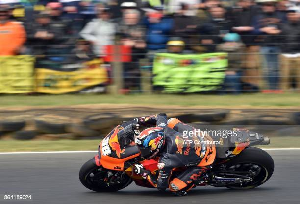 Red Bull KTM rider Bradley Smith of Britain powers his machine during the qualifying session of the Australian MotoGP Grand Prix at Phillip Island on...