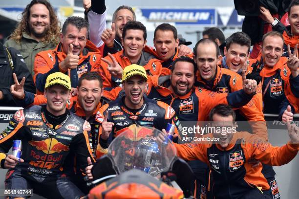 Red Bull KTM rider Miguel Oliveira of Portugal celebrates his victory with team members after the Moto2class Grand Prix of the Australian MotoGP...