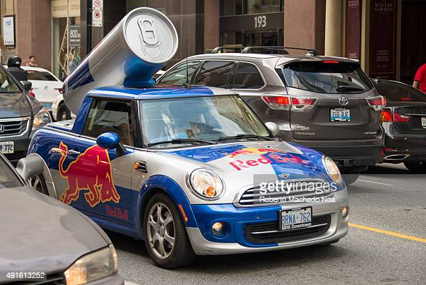Red Bull mini cooper publicity car with a can of red bull drink Red Bull is an energy drink sold by Austrian company Red Bull GmbH created in 1987