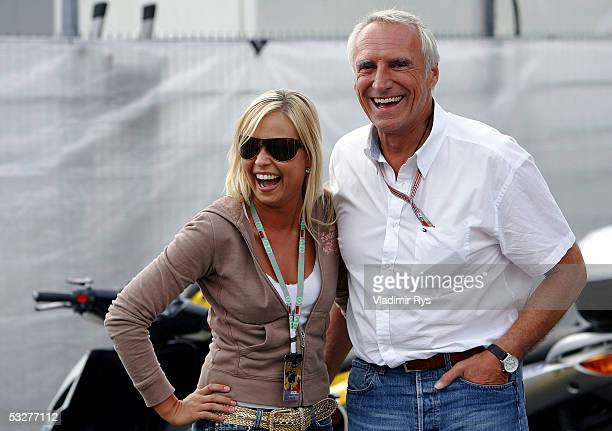 Red Bull owner Dietrich Mateschitz chats with a woman in the paddock after qualifying for the German F1 Grand Prix on July 23 2005 in Hockenheim near...