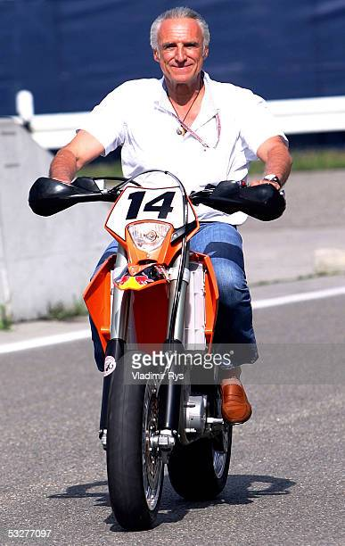 Red Bull owner Dietrich Mateschitz drives motorbike after the practise for the German F1 Grand Prix on July 23 2005 in Hockenheim near Heidelberg...