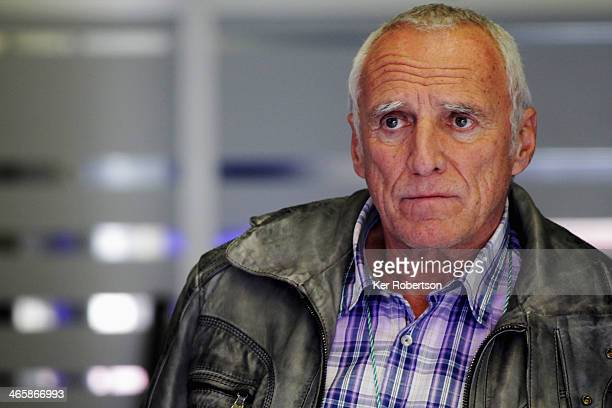 Red Bull owner Dietrich Mateschitz watches the lap times in the team garage during day three of Formula One Winter Testing at the Circuito de Jerez...