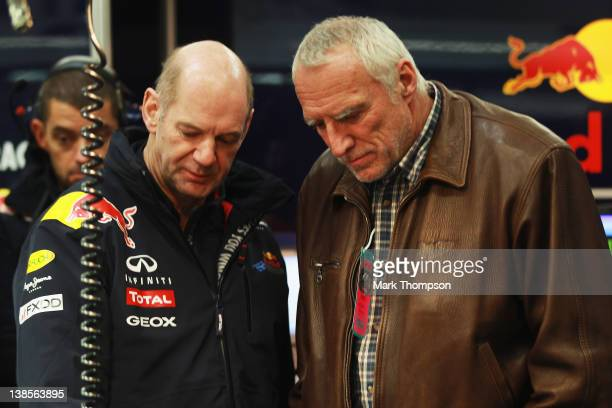 Red Bull Racing Chief Technical Officer Adrian Newey talks with Red Bull Racing team owner Dietrich Mateschitz in their team garage during day three...