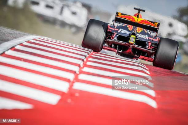Red Bull Racing driver Daniel Ricciardo of Australia drives through turn 9 during qualifying for the Formula 1 United States Grand Prix on October 21...