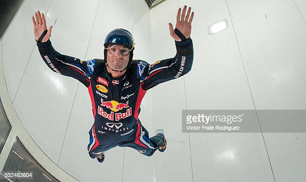 Red Bull Racing driver Mark Webber of Australia practices indoor skydiving in a vertical wind tunnel with top skydiver Jon DeVore of USA during the...