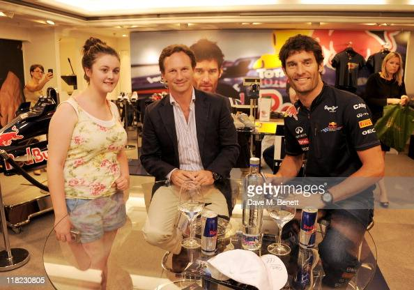 Red Bull Racing F1 Team Principal Christian Horner and Red Bull Racing Driver Mark Webber sign autographs at the launch of the limited edition...