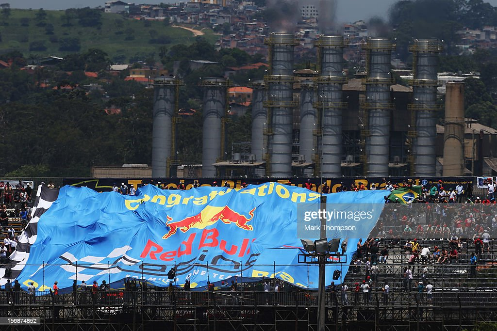 Red Bull Racing fans unfurl a giant flag during practice for the Brazilian Formula One Grand Prix at the Autodromo Jose Carlos Pace on November 23, 2012 in Sao Paulo, Brazil.