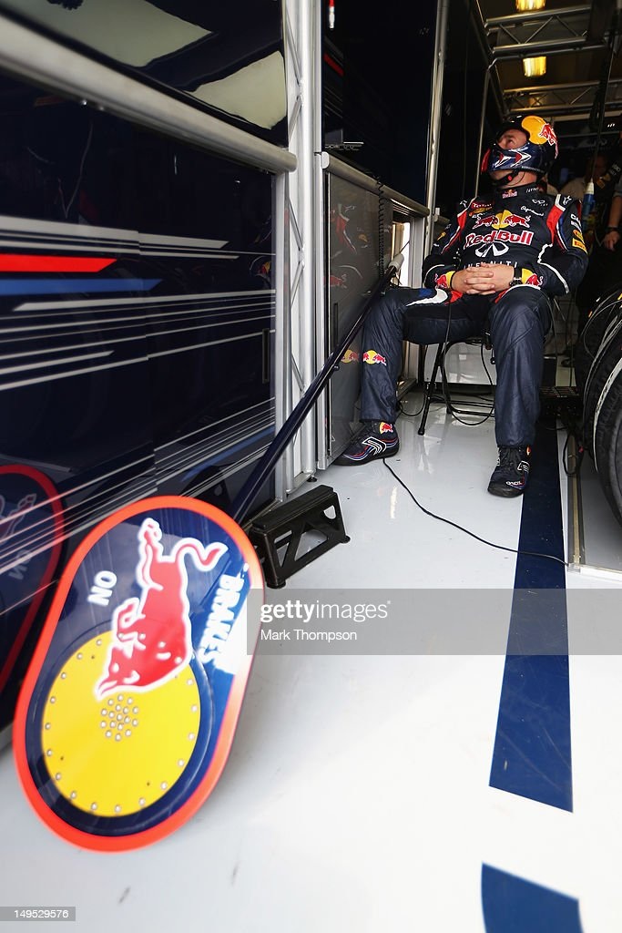Red Bull Racing mechanic follows the race in his team garage during the Hungarian Formula One Grand Prix at the Hungaroring on July 29, 2012 in Budapest, Hungary.