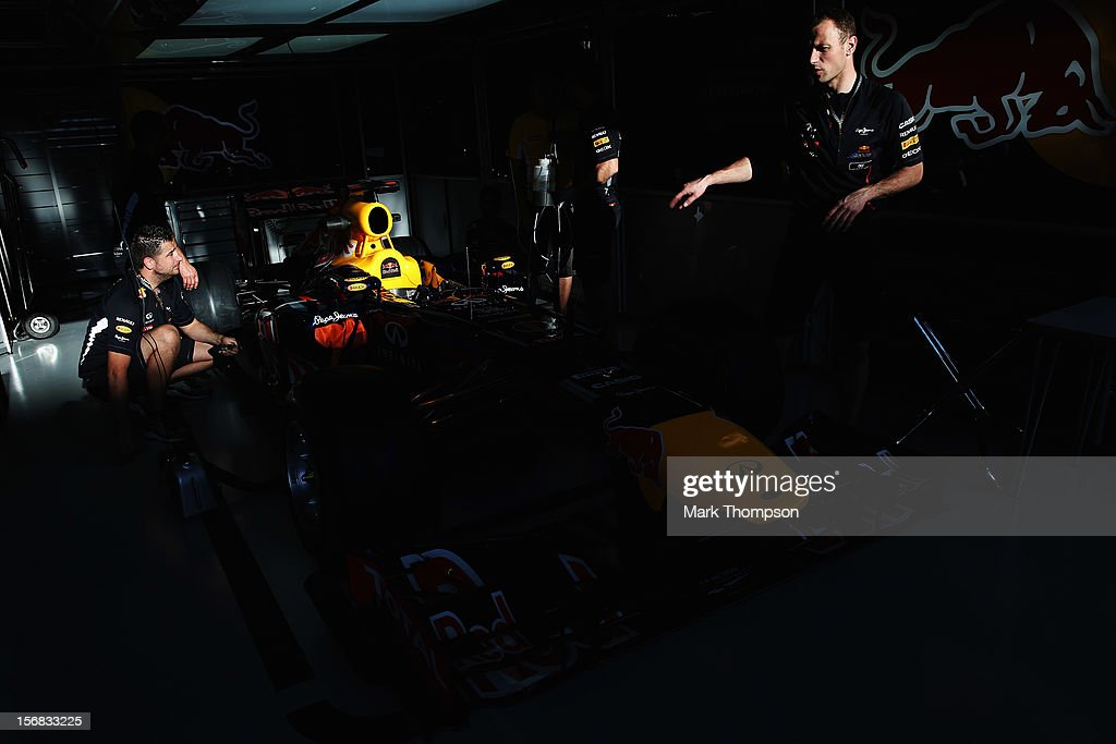 Red Bull Racing mechanics at work during previews for the Brazilian Formula One Grand Prix at the Autodromo Jose Carlos Pace on November 22, 2012 in Sao Paulo, Brazil.