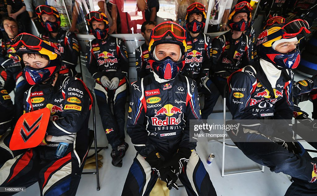 Red Bull Racing mechanics follow the race in their team garage during the Hungarian Formula One Grand Prix at the Hungaroring on July 29, 2012 in Budapest, Hungary.