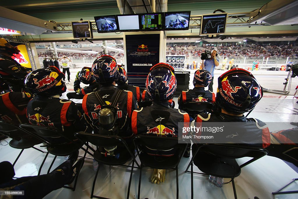 Red Bull Racing mechanics watch the closing stages of the Abu Dhabi Formula One Grand Prix at the Yas Marina Circuit on November 4, 2012 in Abu Dhabi, United Arab Emirates.