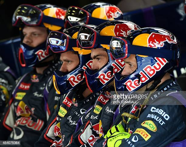 Red Bull Racing team members look at a control screen in the pit at the SpaFrancorchamps circuit in Spa on August 24 2014 during the Belgium Formula...