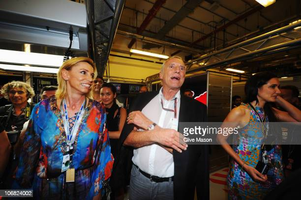 Red Bull Racing team owner Dietrich Mateschitz celebrates in their team garage following the Abu Dhabi Formula One Grand Prix at the Yas Marina...