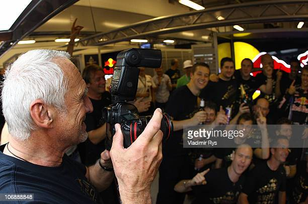 Red Bull Racing Team owner Dietrich Mateschitz takes a picture of the team of Sebastian Vettel of Germany and Red Bull Racing after winning the...