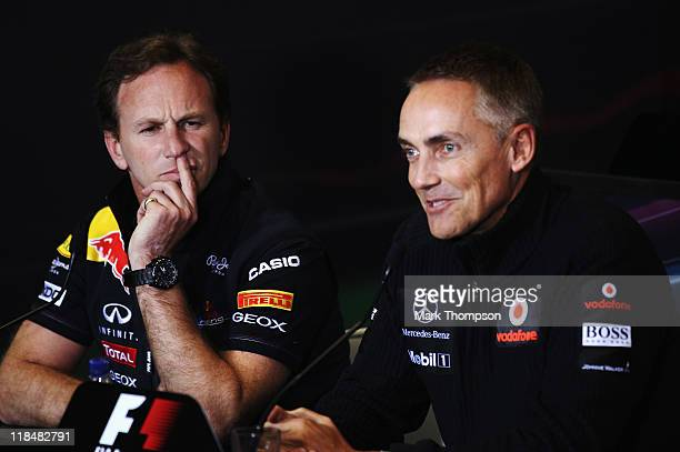 Red Bull Racing Team Principal Christian Horner and McLaren Team Principal Martin Whitmarsh attend the FIA official press conference following...