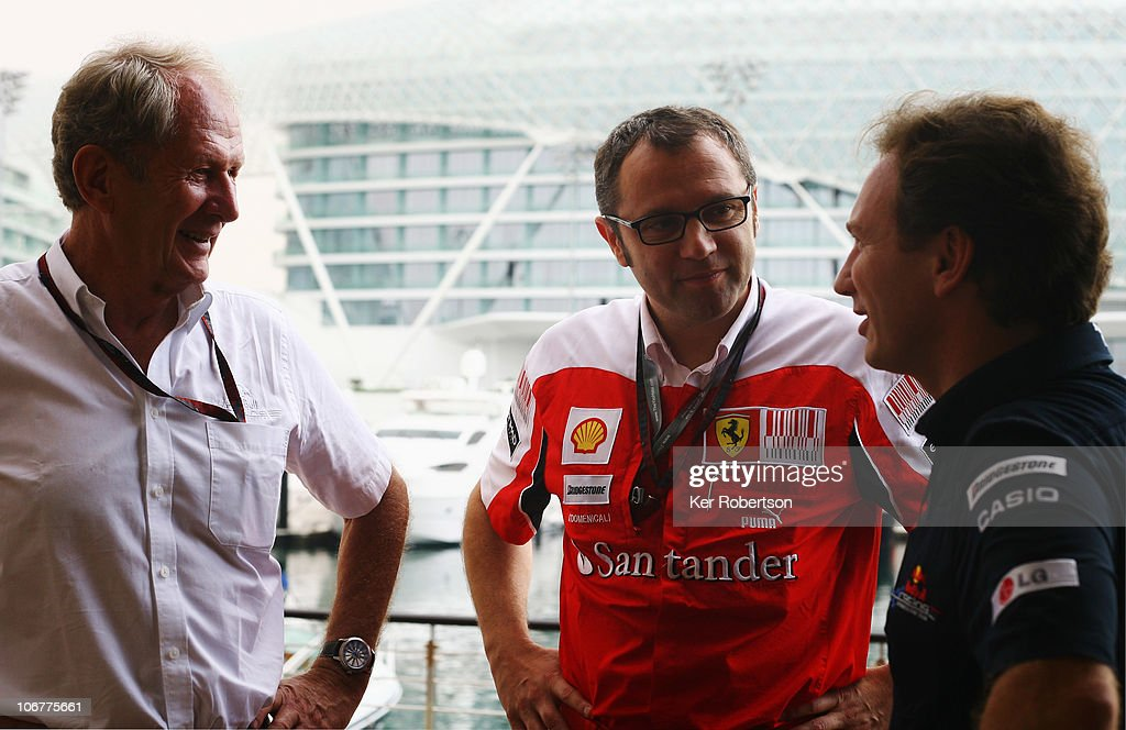 Red Bull Racing Team Principal <a gi-track='captionPersonalityLinkClicked' href=/galleries/search?phrase=Christian+Horner&family=editorial&specificpeople=228706 ng-click='$event.stopPropagation()'>Christian Horner</a> (R) and Red Bull Racing Motosport Consultand Dr Helmut Marko (L) talk with Ferrari Team Principal <a gi-track='captionPersonalityLinkClicked' href=/galleries/search?phrase=Stefano+Domenicali&family=editorial&specificpeople=544864 ng-click='$event.stopPropagation()'>Stefano Domenicali</a> (C) before practice for the Abu Dhabi Formula One Grand Prix at the Yas Marina Circuit on November 12, 2010 in Abu Dhabi, United Arab Emirates.