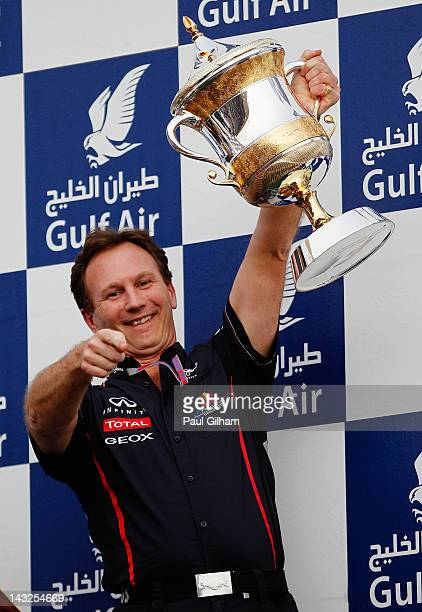 Red Bull Racing Team Principal Christian Horner celebrates on the podium with the Constructors Trophy following the Bahrain Formula One Grand Prix at...